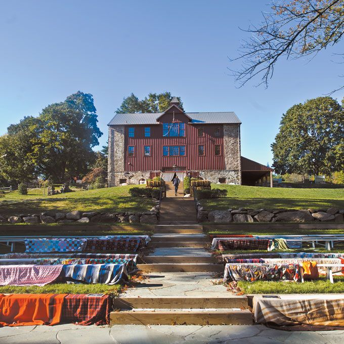 The ceremony was held in the farm's amphitheater; benches were decorated with quilts loaned by family members. Photo: Vantage Pictures.
