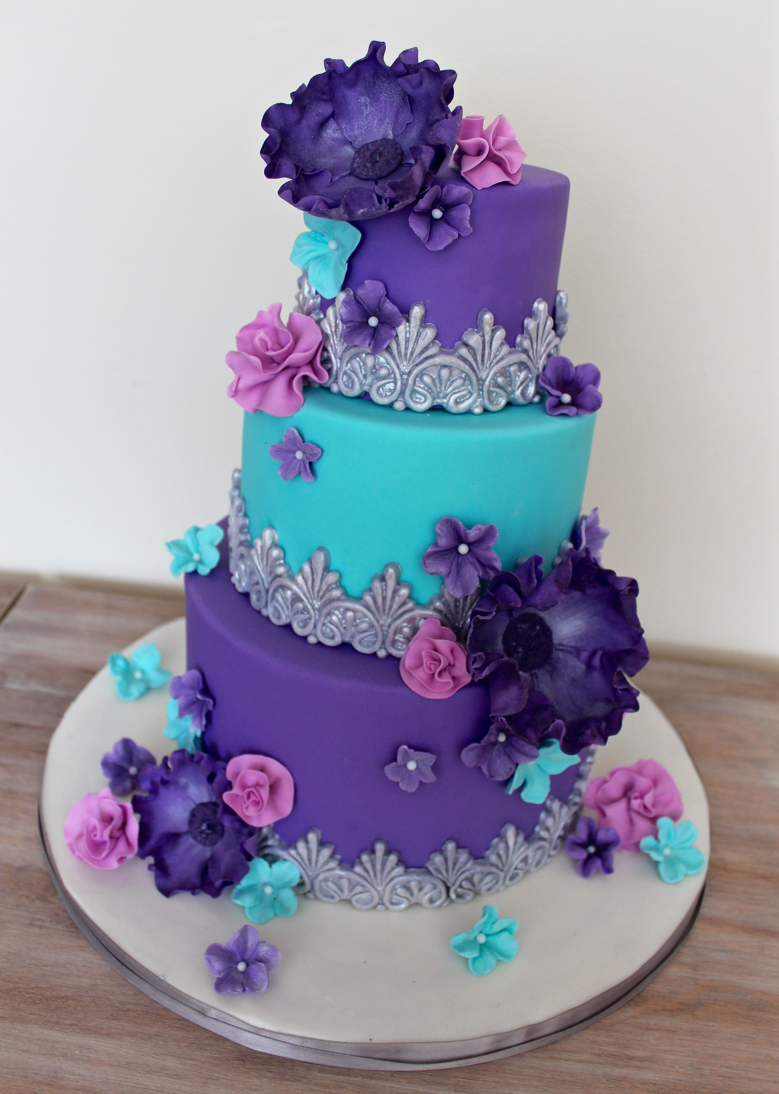 Whimsical Purple Turquoise And Pink Cake With Silver Fantasy Sugar Flowers Purple
