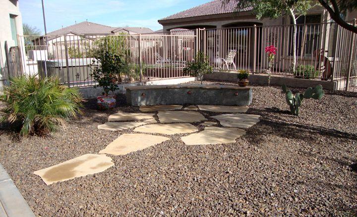 Arizona desert landscape designs with riverbeds  rock  desert plants. Desert Landscaping Flagstone az flag stone flush with the ground