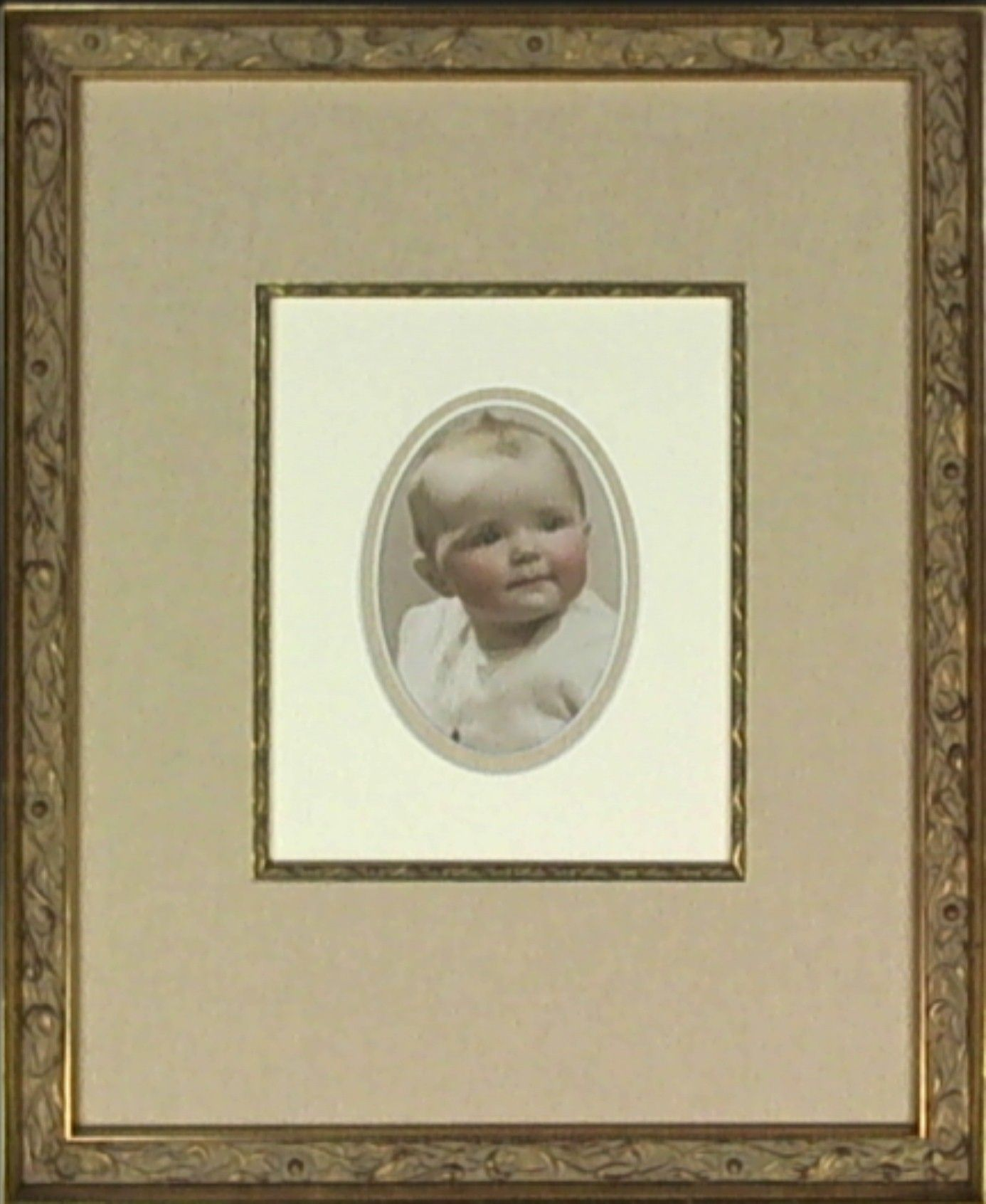 This Antique Baby Photograph Is Displayed Using An Interior Oval Mat