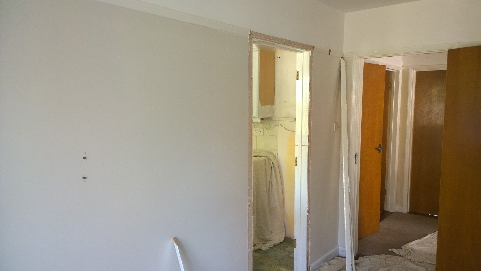 1960's Bungalow. Kitchen and Dining Room. Refurbished to Kitchen Diner. This is the before photo.