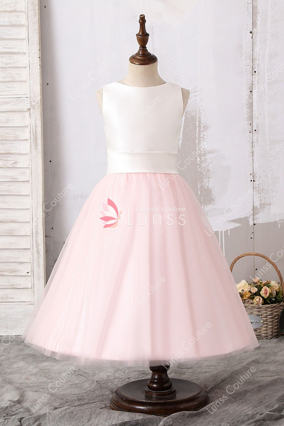 d6b22b99489 This adorable two-tone tea-length flower girl dress comes with ivory soft  satin tank bodice and light pink puffy tulle skirt with a detachable ribbon.