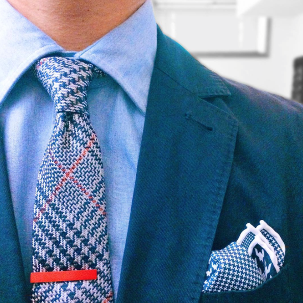 Our skinny plaid tie in action with our red tie bar.