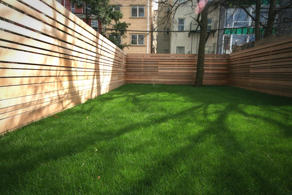 Horizontal fence design I'm thinking this would look more finished with possible vertical boards and a climbing plants.