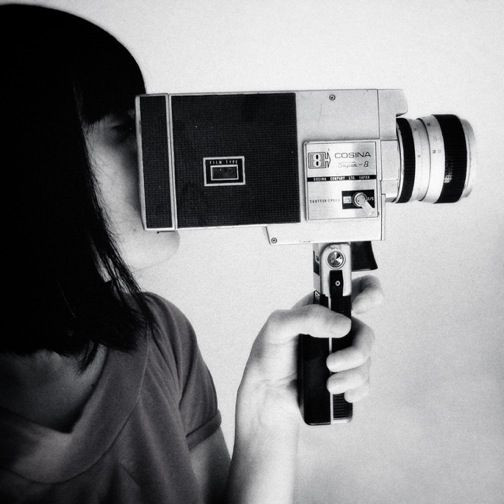 Girl holding a Super 8 camera made by Japanese company Cosina, in ...