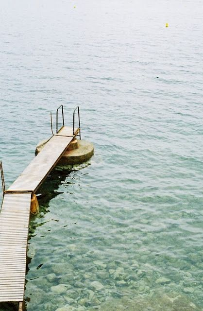 A long, wooden dock out into the ocean