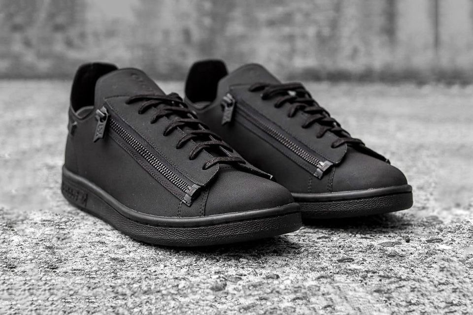 45fa3404376f9 This avant-minded rework of the classic Stan Smith features a one-piece  upper with an updated tongue and heat-pressed heel tab.