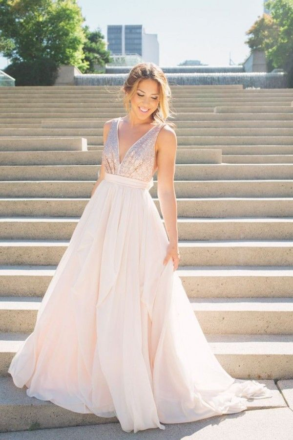 """Relatively new to the bridal scene, Vancouver-based designer Gabrielle Bayona created Truvelle in 2013 for brides with a taste for the modern and non-traditional. Epitomizing the brand's laidback spirit is the """"Julia"""", a rose gold sequined wedding dress, catered to the girl who will """"dance like nobody's watching, dye her hair a new colour just because she can, and create something out of nothing"""". We love this dress for its dazzling yet simple design."""