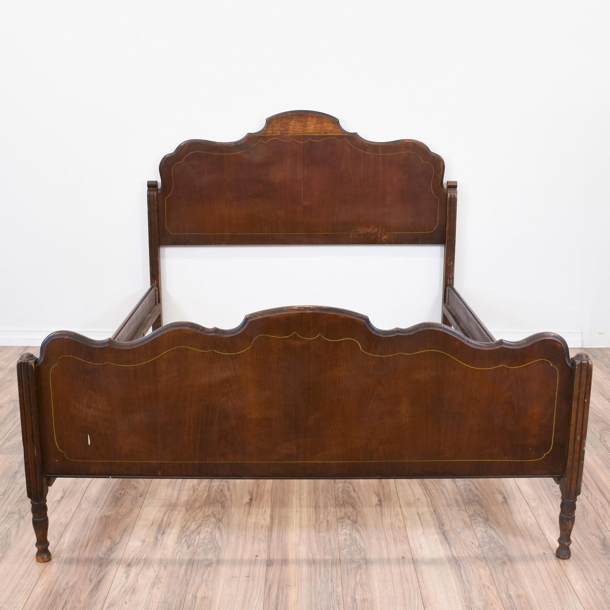 This antique bed is featured in a solid wood with a rustic