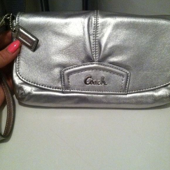 2371a480f8 Authentic coach wristlet Authentic silver coach wristlet also strap can be  attached to other side to fit like a small purse. Perfect for going out.