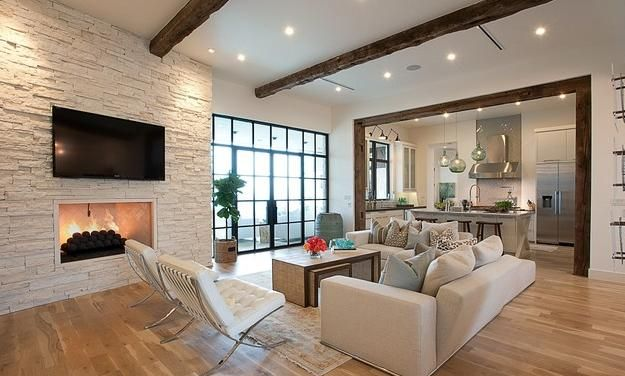 wandgestaltung stein weiß gaskaminofen laminatboden wohnzimmer