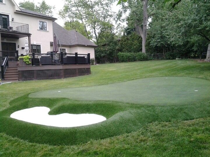 New backyard putting green for a golfing family with ...