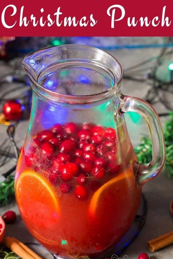 This festive season bring your friends and family together with a lovely fruity Christmas punch packed with fruits like cranberries, orange, pomegranate.  #Christmaspunch #holidaypunch #Christmasrecipes #Thanksgivingrecipes #easy #easyrecipes #foracrowd #recipes #champagne #cranberry #spiked #alcoholic #nonalcoholic #rum #holidayrecipes #holidaydrinks #cocktail #fallrecipes #falldrinks #hot #simple #boozy #boozydrinks