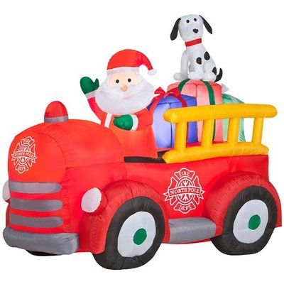 The Holiday Aisle Airblown Santa Driving Vintage Fire Truck Scene