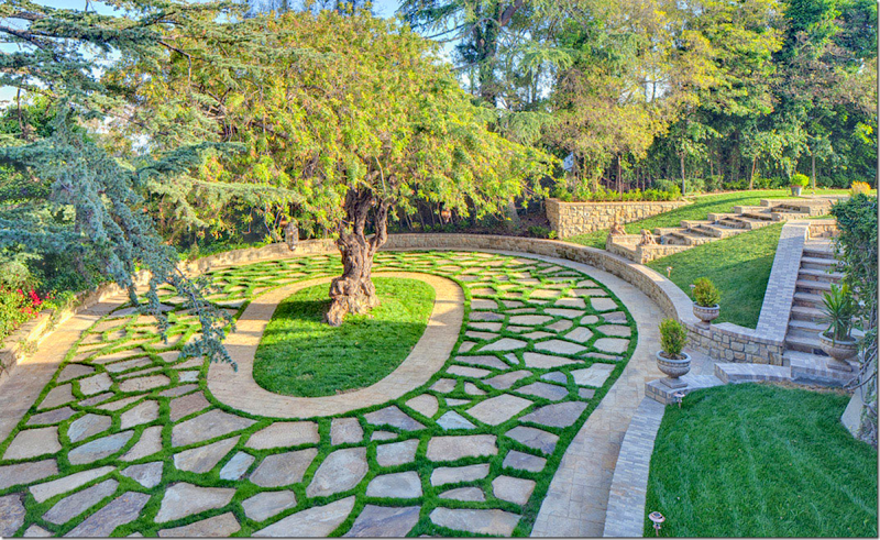 Stone and grass driveway for circular driveway over for Garden design ideas for driveways