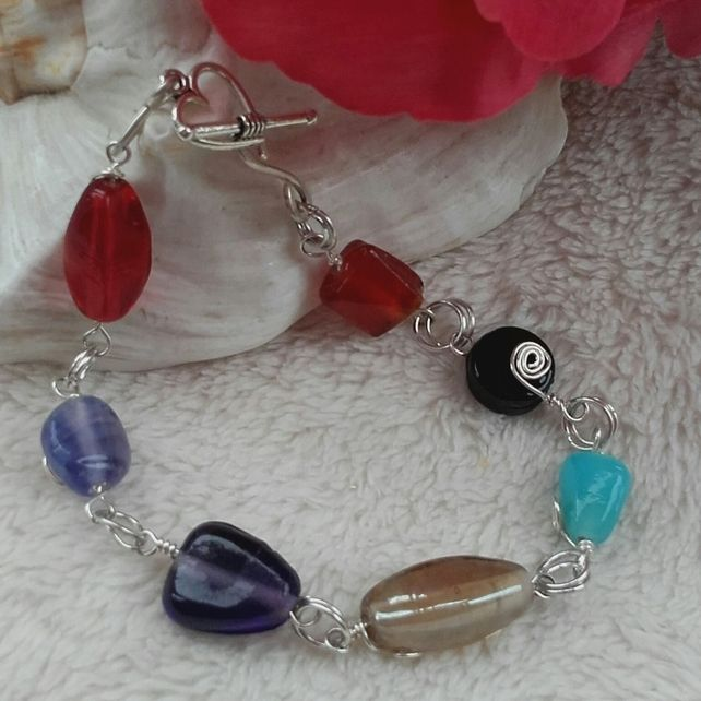 Handmade Silver Bracelet with Blue, Black, Purple and Orange glass beads. £6.00