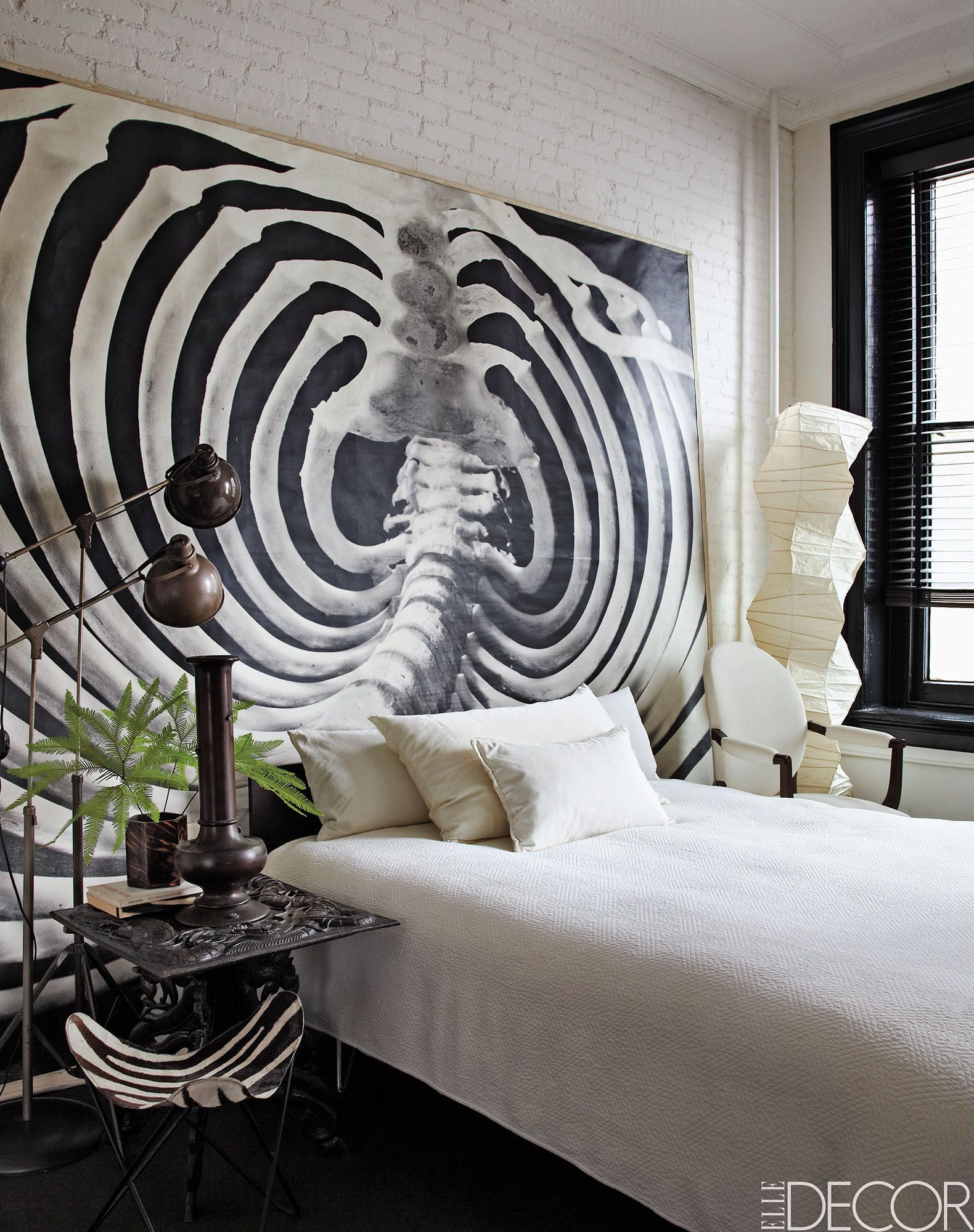 Large scale art as headboard eclectic bedroom decor standing paper