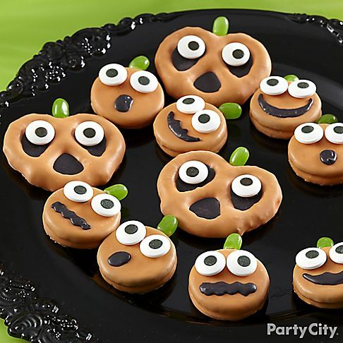Put together a platter-o'-pumpkins for endless snacking fun! Click for our Pumpkin Funny Face Cookies & Pretzels how-to for this medley of sweet treats!