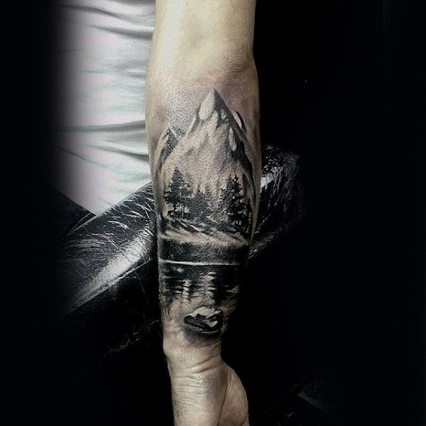 Black And White Forearm Tattoo Of Mountains With Forest And Lake