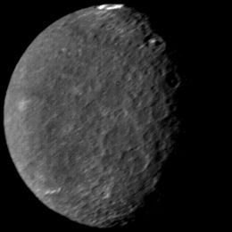 Umbriel is a moon of Uranus discovered on October 24, 1851, by William Lassell. Umbriel consists mainly of ice with a substantial fraction of rock, and may be differentiated into a rocky core and an icy mantle. The surface is the darkest among Uranian moons, and appears to have been shaped primarily by impacts.
