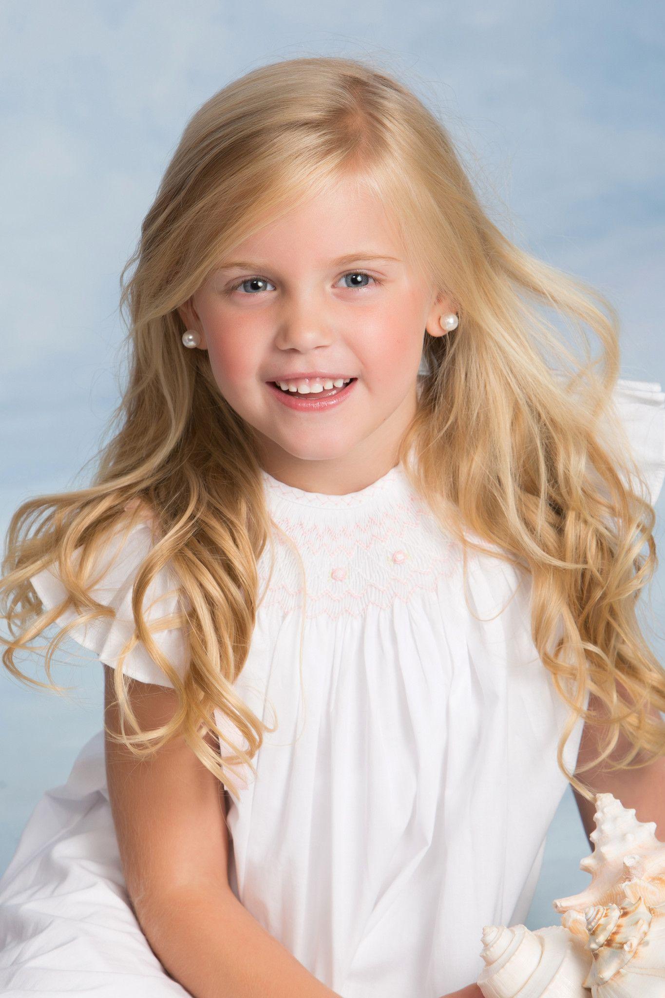 A little cutie in her smocked Strasburg Children bishop dress #EasterDress #grandkids #cute