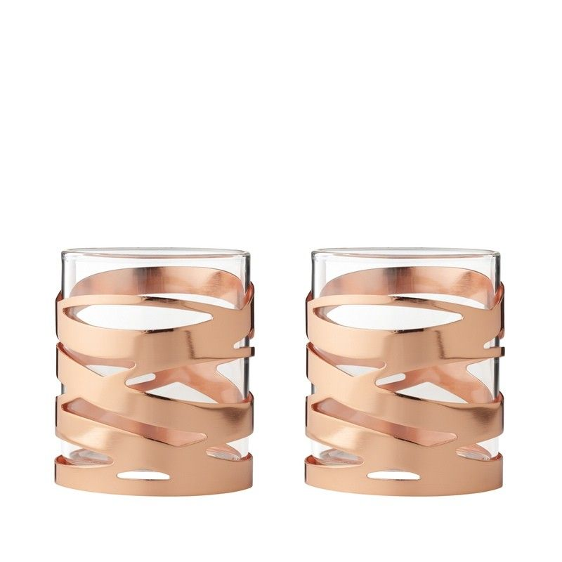 The Stelton Tangle Tealights in copper is created with very pleasing design of intertwining copper bands that wind smoothly round the glass body. The use of lacquered copper as a finish give it a lovely soft look, a real luxury look.