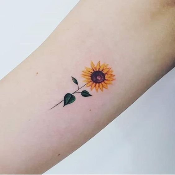18 Simple And Small Flower Tattoos That You Ll Love Sunflower Tattoo Small Sunflower Tattoo Sunflower Tattoo Design