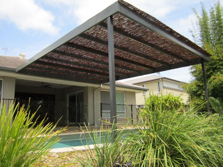 Queensland patio over pool, with a bamboo roof for filtered shade