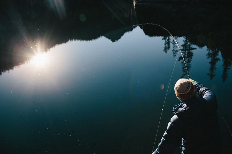 The sun and mountains reflecting onto the water serve as a beautiful distraction while anticipating the feeling of a taut line. #flyfishing Photo: Forest Woodward