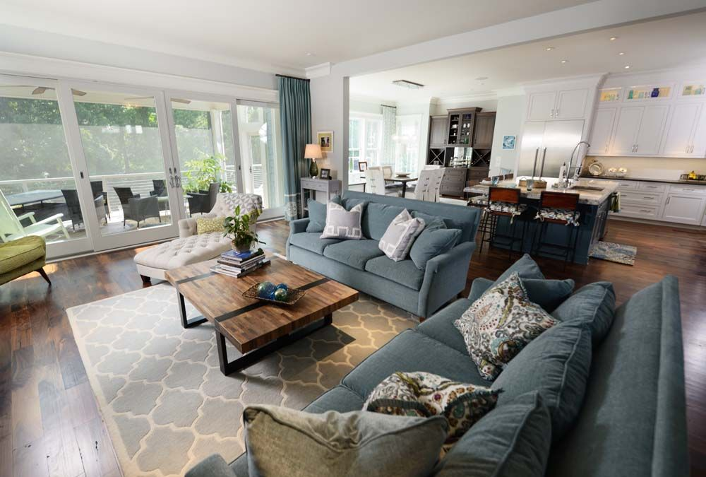 modern open space with living dining and kitchen areas. Couture Haus Interior Design. Raleigh.