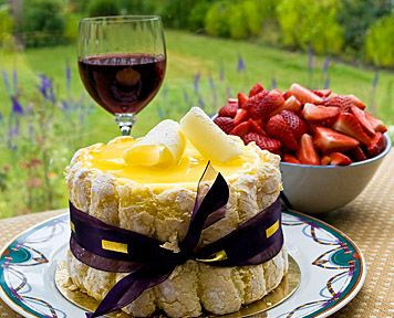 beautiful ladyfinger and lemon cake with strawberries and wine
