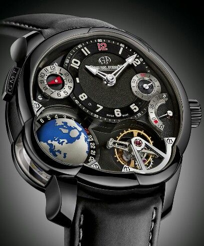 Greubel Forsey Unveils The GMT Black In ADLC Titanium - Making its debut at SIHH 2015, the Greubel Forsey GMT Black is fundamentally identical to the precious metal versions of the GMT, except for the case. Made of lightweight titanium and coated with a glossy black amorphous diamond-like carbon (ADLC) layer, the case has the same chunky dimensions as before, at 43.5 mm wide and 16.14 mm high. The movement has been finished with a black coat in on the bridges to match the case, making the…
