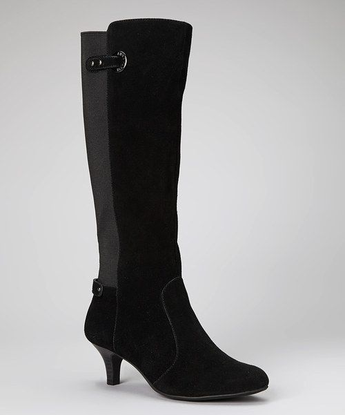 Make a bold fashion statement without shouting too loudly in these beautiful boots. Luxurious black suede on a classic silhouette creates a sleek look, while the heel adds a stylish boost of height.2'' heel15'' shaft14.25'' circumferenceZipper closure