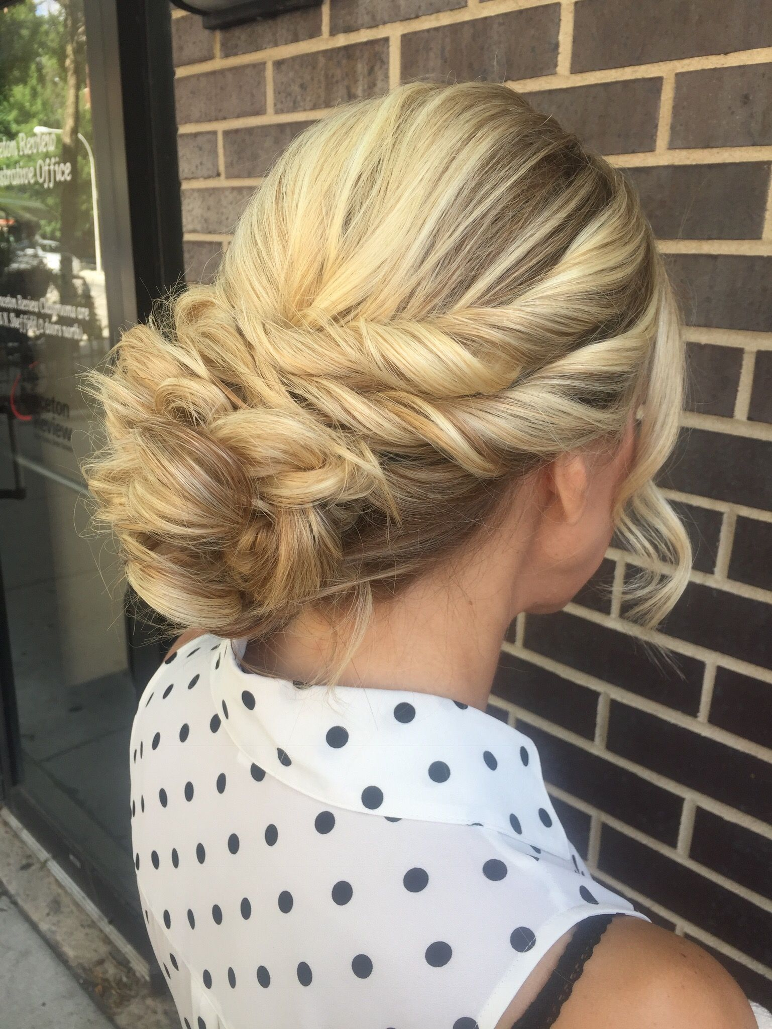 This elegant hairstyle features a double twisted crown curly updo
