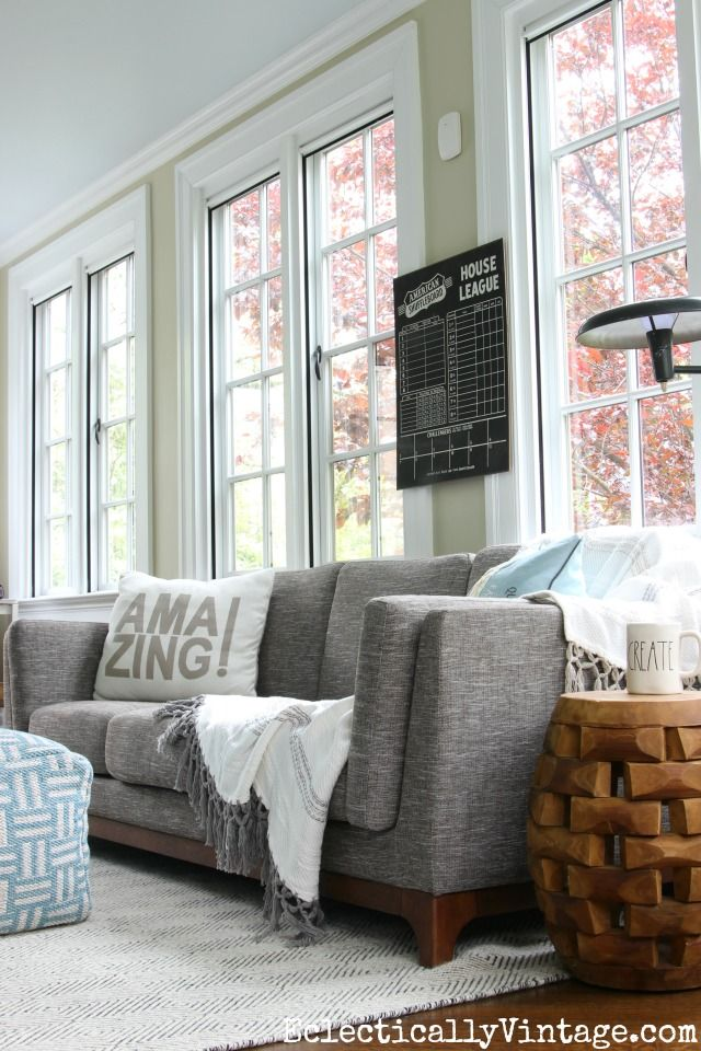 Love All The Windows In This Beautiful Sunroom And The Gray Sofa  Eclecticallyvintage.com