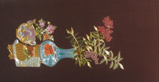 Flowers with vase, hand embroidered with gold and silver metallic threads.