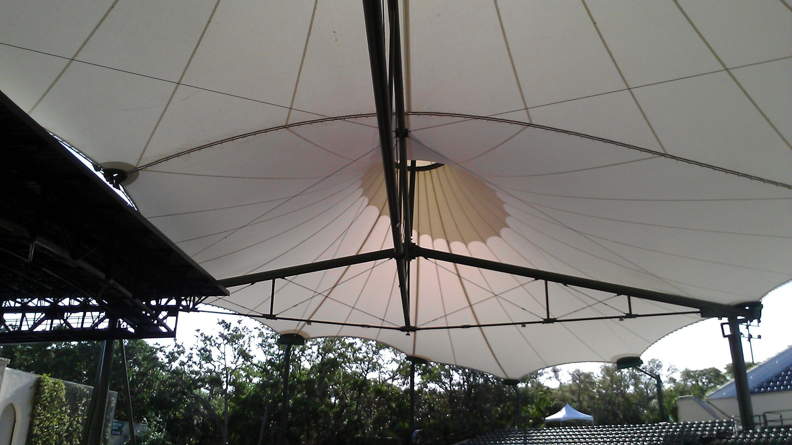 The large umbrella roof protects concert goers from the elements. #largeumbrella The large umbrella roof protects concert goers from the elements. #largeumbrella