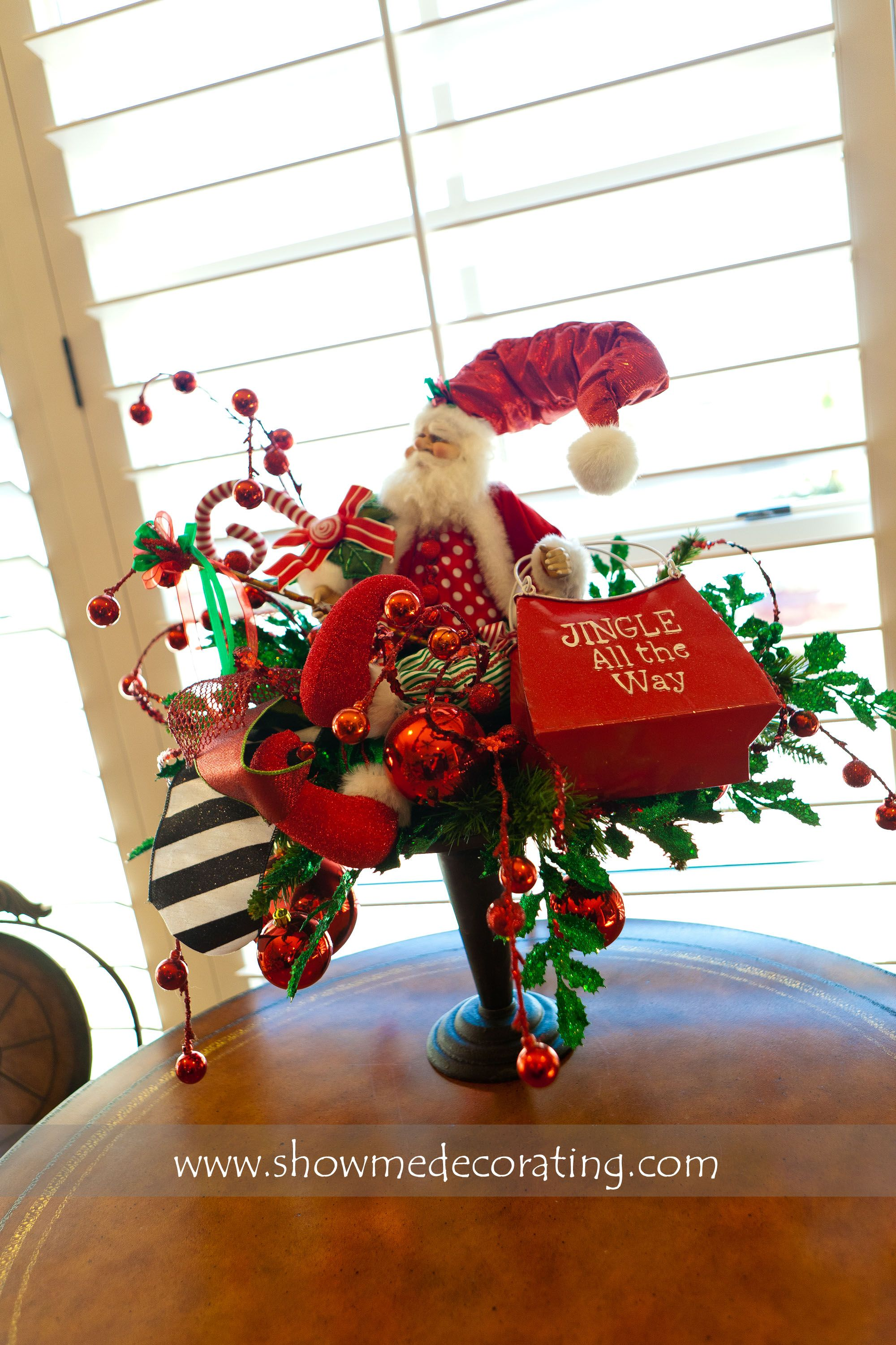 Santa Centerpiece brings Christmas cheer to any room.  www.showmedecorting.com