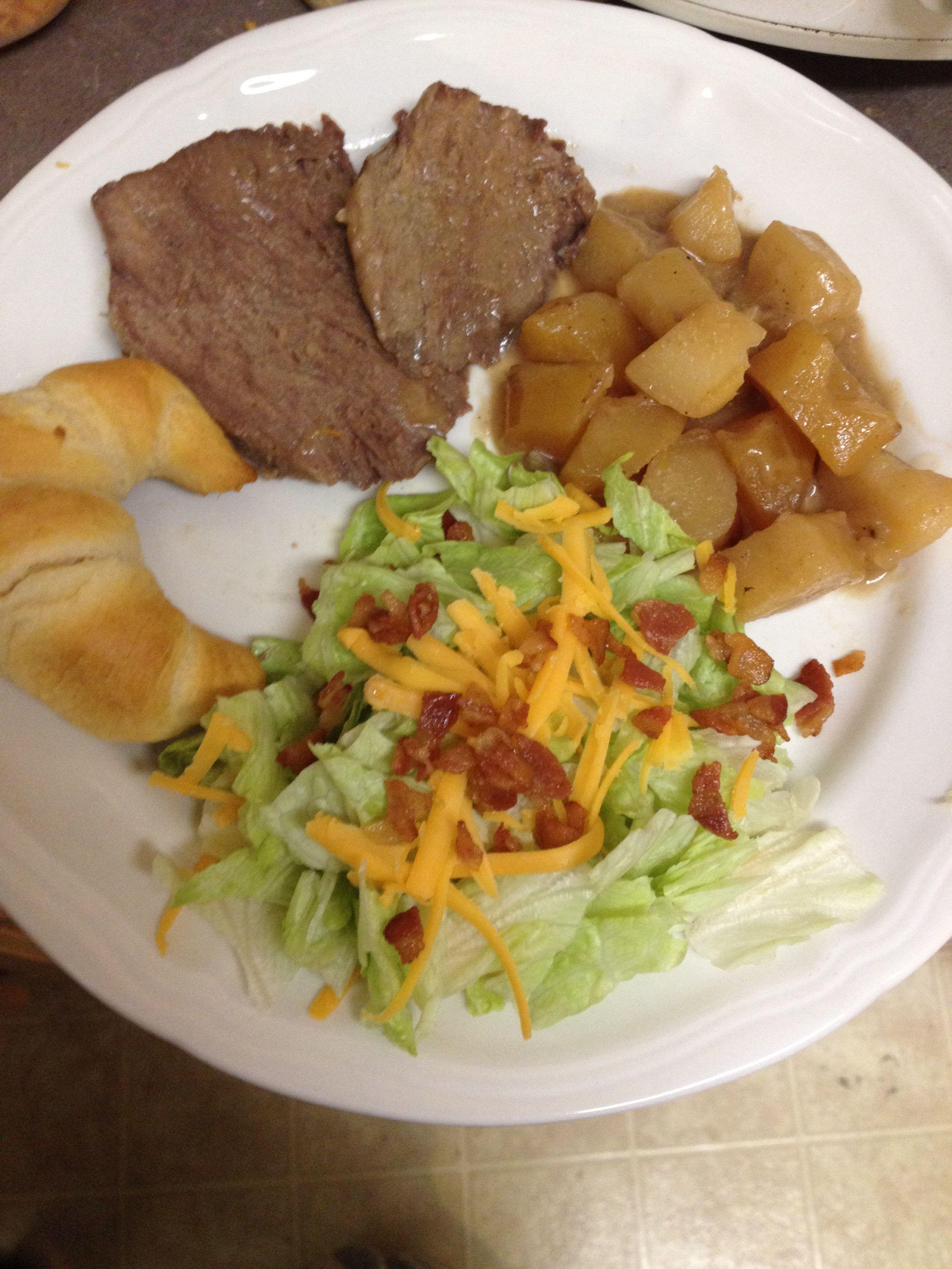 Tender beef roast and potatoes