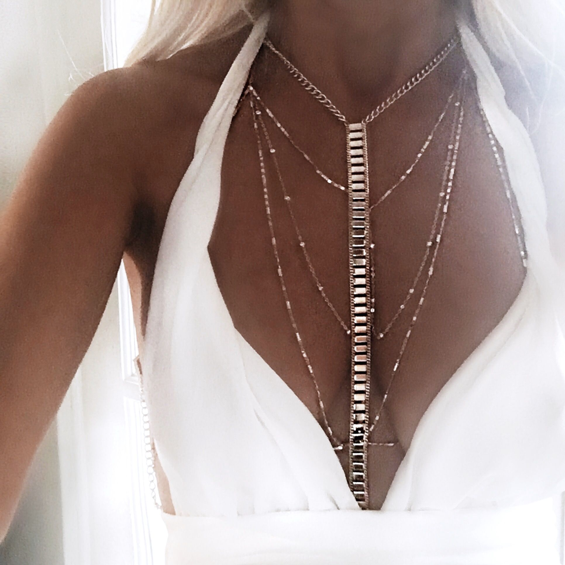 Delicate body harness made from fine chain – clips at the ...