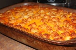 Could be my husband's dream...Tator Tot Breakfast Casserole. Sausage, egg, milk, shredded cheese, tator tots and velvetta cheese.
