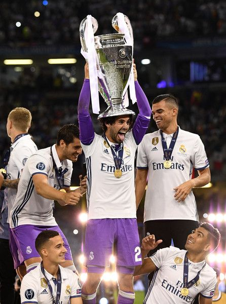 Isco of Real Madrid celebrates with The Champions League trophy after the UEFA Champions League Final between Juventus and Real Madrid at National Stadium of Wales on June 3, 2017 in Cardiff, Wales.