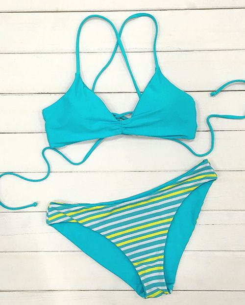 The designers clearly used all their sweet tricks on this bikini set! The top features a bralette-inspired design with cute bright color, ending with a criss-cross tie closure at the back. Pair with the same cute striped bottom. Ready for a bright beach time?