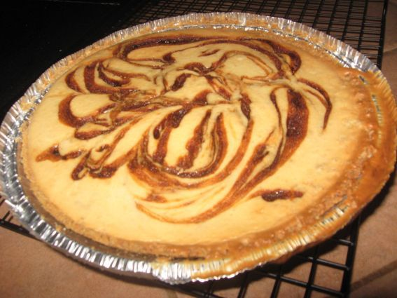 Bananas Foster Cheesecake Recipe | BakePlans.com whoa mama! May have to save this for Christmas dinner!