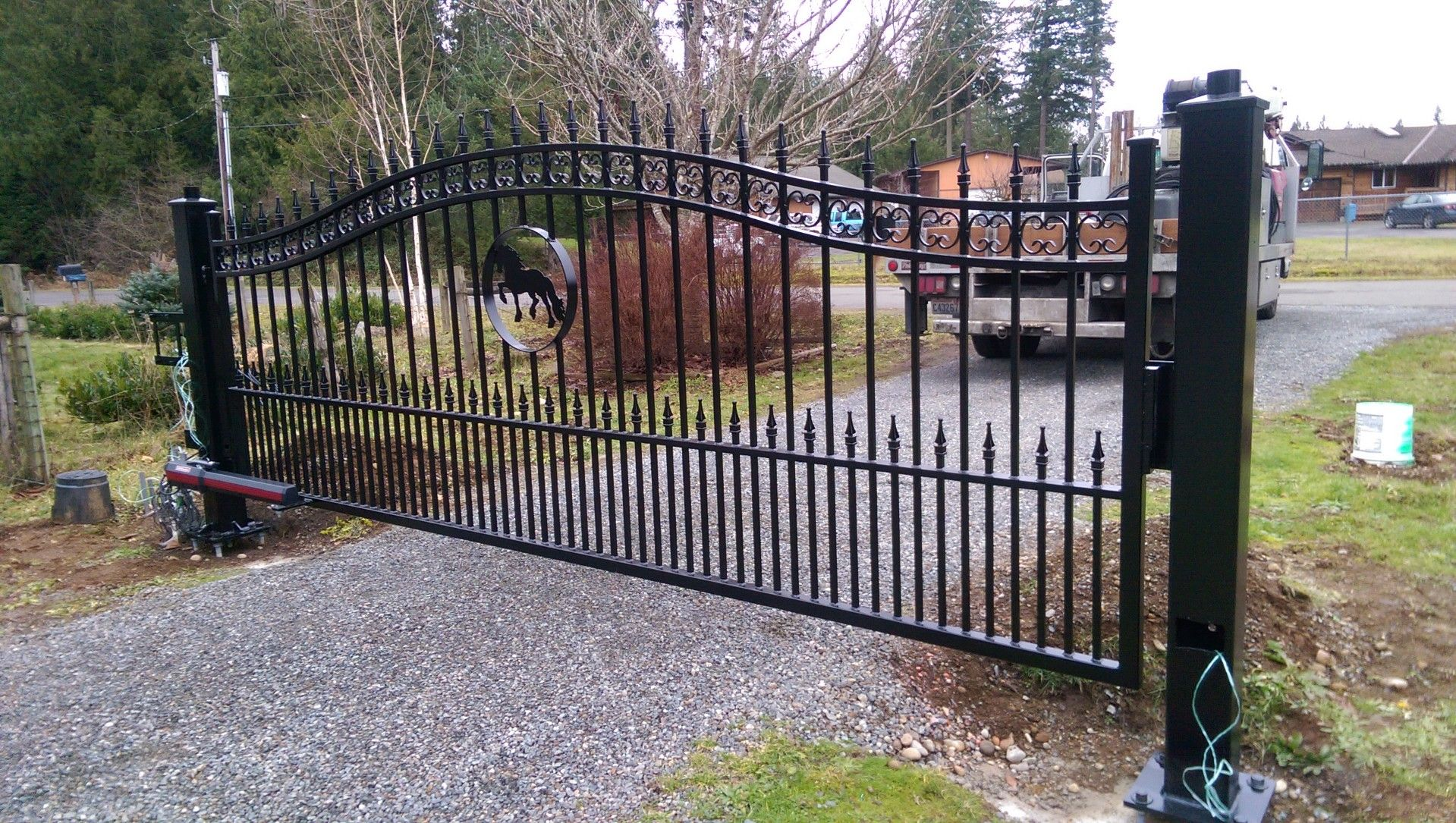 Iron Single Swing Gate With Dog Pickets And Custom Designed Horse Artwork Iron Security Ornamental Drivew Custom Iron Gates Iron Gates Iron Gates Driveway