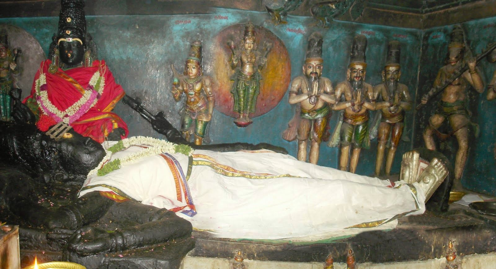 Sri Pallikondeshwara swamy temple at Surutapalli. The Lord Shiva in sleeping position with his head on the lap of the Goddess Parvati, surrounded by the Lord Brahma, Lord Vishnu, Mukoti Devas Maharishis and Sages creates an atmosphere of Kailash (Heaven). It is only temple where Lord Shiva is seen in the human form.