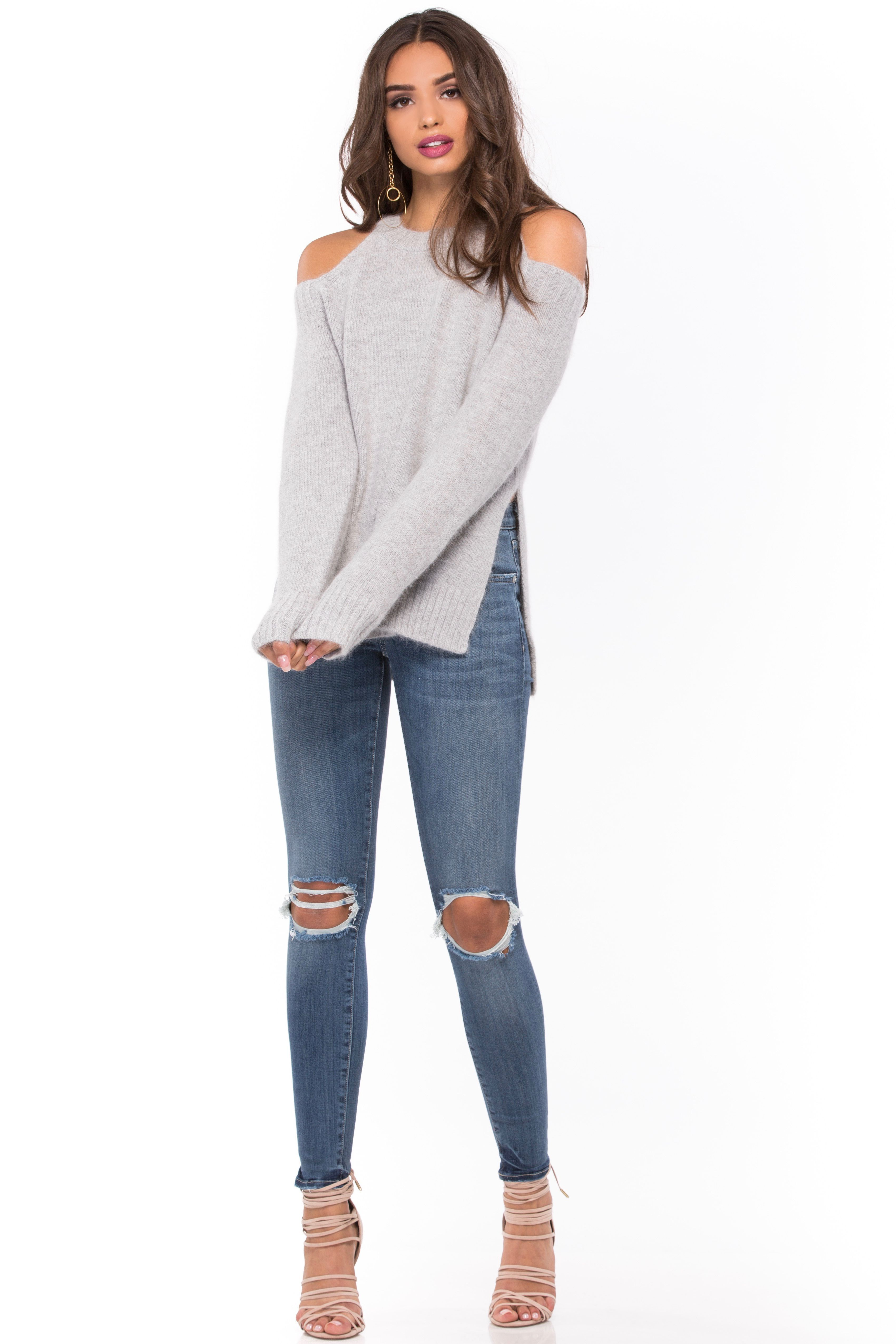 4b52510378 The Cold Shoulder Sweater by J.O.A. features shoulder cutouts and a split  hem. 50% Nylon