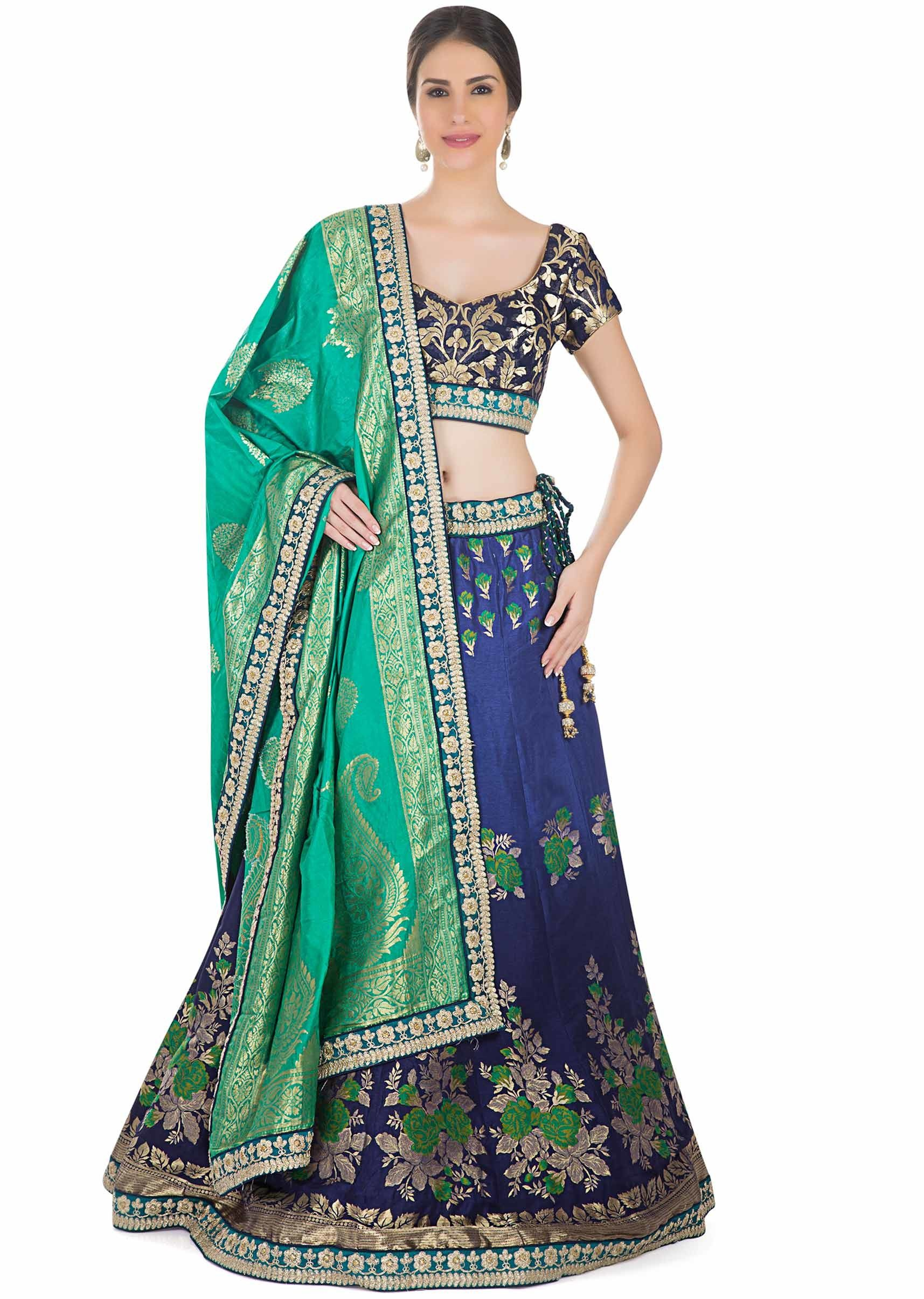 e987fad2d3 This ethnic ensemble offers the classic peacock colour combination. The  brocade silk of the blouse and the lehenga flaunts attractive woven floral  pat