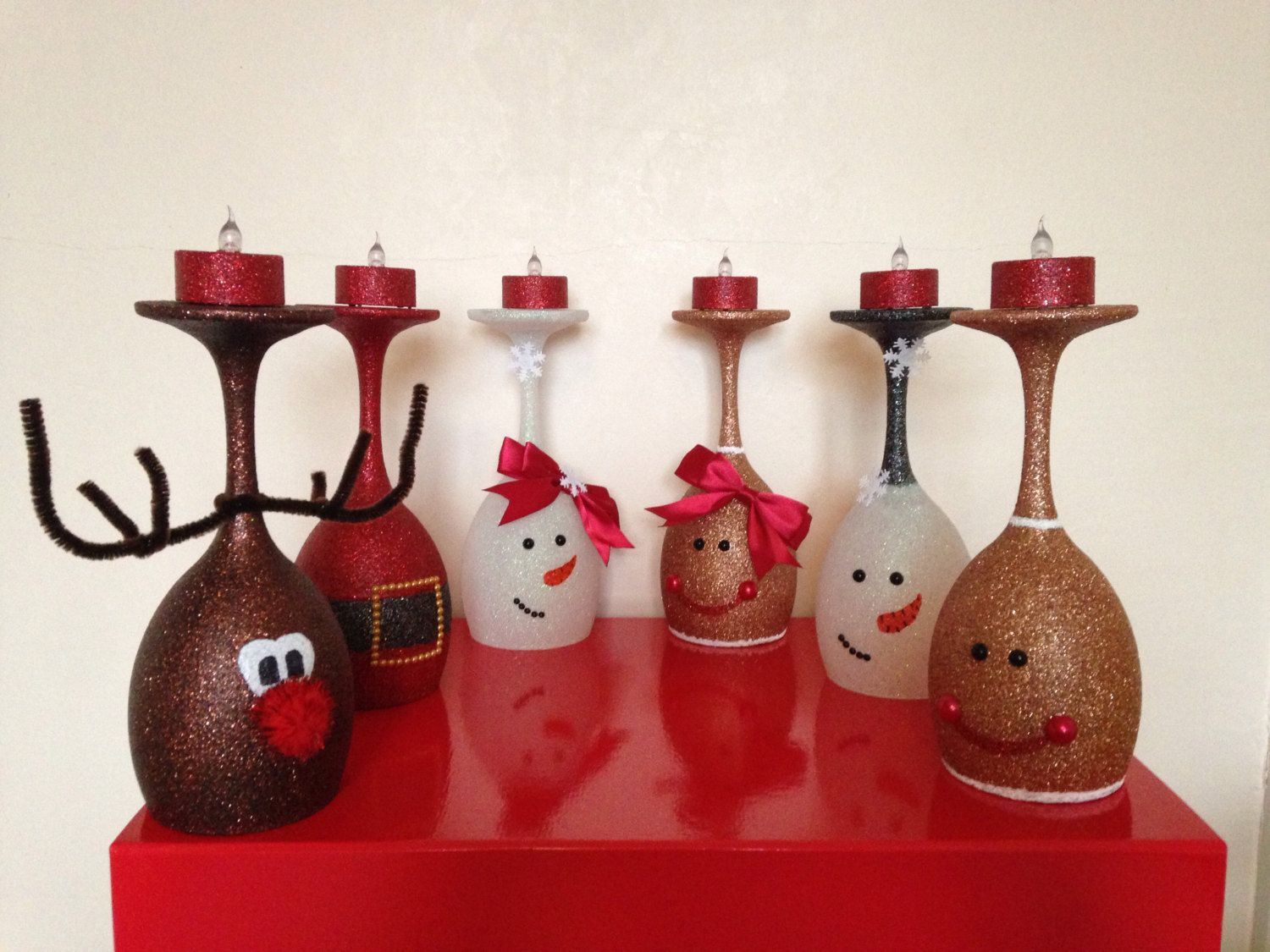 Glittered christmas wine glass candle holders by for Holiday wine glass crafts