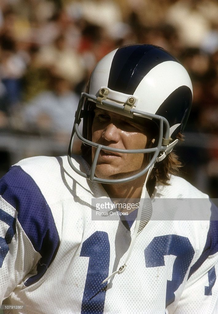 Wide Receiver Lance Rentzel  13 of the Los Angeles Rams watches the action  from the sidelines against the Atlanta Falcons during an NFL football game  at ... 891e5227c